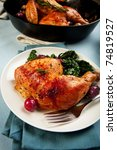 Chicken leg quarter with black Tuscan kale - stock photo