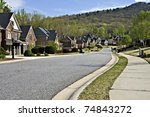 Sidewalk and street in a beautiful modern nieghborhood. - stock photo