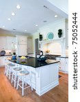 trendy expensive kitchen with white and oak - stock photo