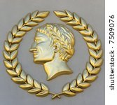 Caesar relief with golden wreath - classical wall decoration - stock photo