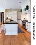trendy modern kitchen with white cabinets and oak floor - stock photo