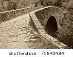 antique roman bridge made with stones - stock photo