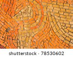 Round orange mosaic texture on the wall - stock photo