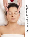 girl receiving facial massage - stock photo