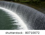 Dam with cascade. - stock photo