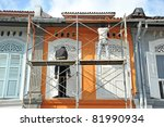 Workers Doing Renovation Work On An Old Building - stock photo