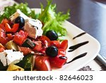 Greek Mediterranean salad with feta cheese, olives and peppers - stock photo