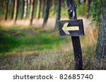 Yellow sign in the forest - stock photo