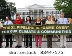 WASHINGTON - AUGUST 25: Protesters of the Keystone XL Pipeline hold a banner in front of the White House before the sixth day of arrests on August 25, 2011 in Washington. - stock photo