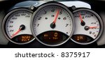 Instrument panel and tachometer from a modern high performance automobile. - stock photo