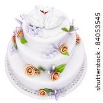 Wedding cake with roses and swans isolated over white - stock photo