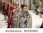 NEW YORK - SEPTEMBER 12: Models walk the runway at the Carolina Herrera S/S 2012 collection presentation during Mercedes-Benz Fashion Week on September 12, 2011 in New York. - stock photo