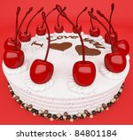 St Valentines day: tasty cake with cherries on red (wide angle) - stock photo