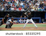 TORONTO, CANADA - AUG 28:  Reigning AL home run king Jose Bautista at bat against the Tampa Bay Rays August 28, 2011 in Toronto, Ontario, Canada. - stock photo