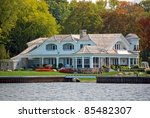 elegant new cottage on the lake - stock photo