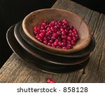 Bowl of Cranberries on Farm Table - stock photo