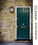 Typical British door with doorbell in West London. - stock photo