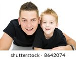 young father and son laughing together - stock photo