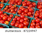 Fresh, organic,hand picked ripe tomatoes for sale at a roadside farm market - stock photo