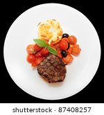 Tasty tenderloin steak with vegetables isolated on black background - stock photo