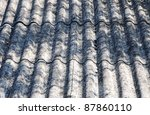 close up on corrugated asbestos roof on byre building in Poland - stock photo