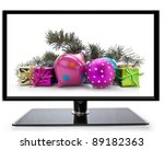 Flat screen TV with Christmas decoration on a white background - stock photo