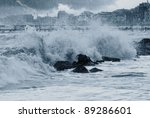 rain over the stormy sea - stock photo
