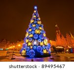 Huge Christmas tree in the city centre at night - stock photo