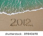 2012 inscription on the sand near the azure sea - stock photo