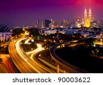Stunning light trail scenery at the busy highway in Kuala Lumpur city at night - stock photo