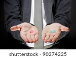 Holding pills in hand - stock photo