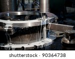 Metal drill - drilling process. Metal industrial machines and tools - stock photo