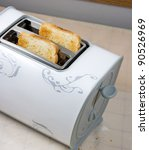 Two baked bread in a fancy toaster - stock photo