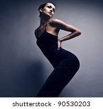 Beautiful woman on black classical dress pose in studio. Vogue style photo. - stock photo