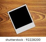 blank vintage paper and photo frame on wooden background - stock photo