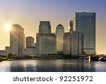 Skyline of Canary Wharf in sunset, London, UK - stock photo