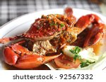 cooked crabs with spicy seafood sauce on white plate , Bali cuisine meal (selective focus) - stock photo