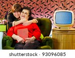 A warm loving portrait of an adult daughter and her elderly mother. - stock photo