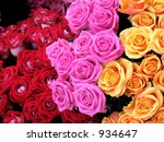 Dozens of red, pink and peach roses in a Paris market - stock photo