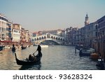 Rialto Bridge and gondolas  in Venice - Italy - stock photo