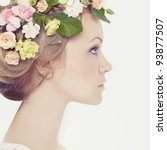 Beautiful young woman with delicate flowers in their hair - stock photo