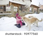 Little girl playing with her labrador friends - stock photo