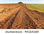 Country road  between two fields. - stock photo