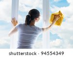 young woman washing windows - stock photo