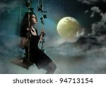 Beauty brunette swinging in night heaven - stock photo