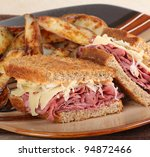Reuben sandwich with fries on a plate - stock photo