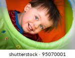Close up portrait of happy smiling little boy - stock photo