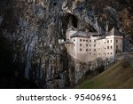 Predjama Castle built into the rocks in central Slovenia - stock photo