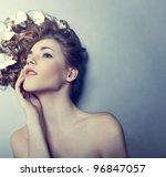 Beautiful young woman with flowers in their hair - stock photo