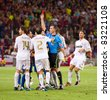 BARCELONA - AUGUST 17: Referee giving red card to Marcelo Vieira during the Spanish Supercup final match between FC Barcelona and Real Madrid, 3 - 2, on August 17, 2011 in Barcelona, Spain. - stock photo